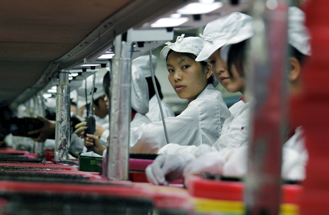 Workers are seen inside a Foxconn factory in the township of Longhua in the southern Guangdong province